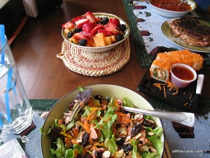 Salad, sushi, fruit