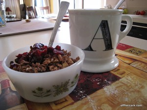 Mug of coffee and bowl of yogurt and granola