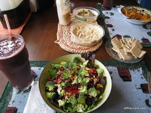 Smoothie, salad, crackers, and hummus