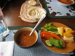 Soup, veggies, and a orange