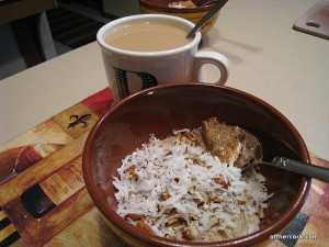 Bowl of oat bran and coffee