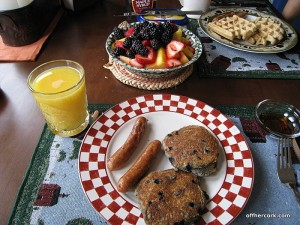 Pancakes, sausage, and fruit