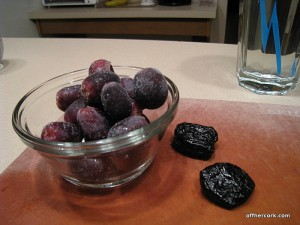Frozen grapes and two prunes
