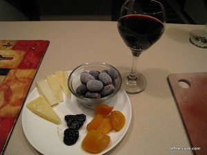 Cheese, frozen grapes, dried fruit, red wine
