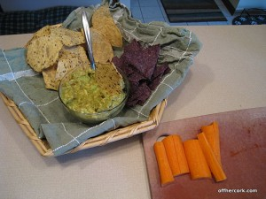 Chips, guacamole, and carrot sticks
