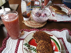 Pancakes, juice, and fruit