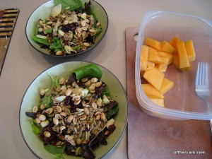 Salad and cantaloupe