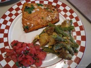 Salmon, potato salad, and watermelon