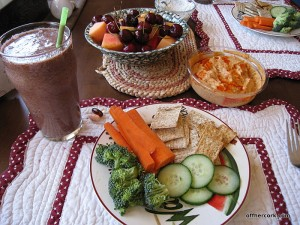 Fruit, hummus, veggies, and crackers