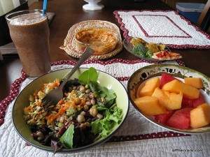Salad, smoothie, crackers, and fruit