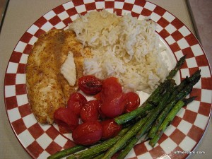 Fish, asparagus, tomatoes, and rice