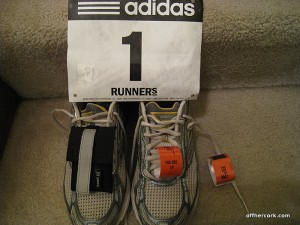 Running shoes and race bib