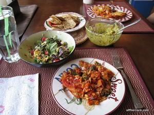 Salad, guacamole, enchilada