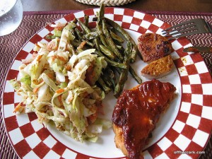 Cole slaw, green beans, pork chop, and salmon burger
