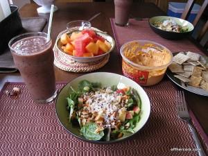 Smoothie, salad, fruit, and hummus