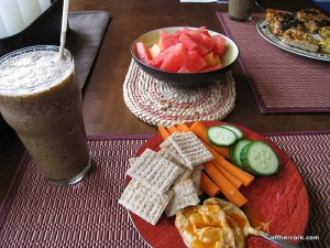 Smoothie, veggies, crackers, and fruit