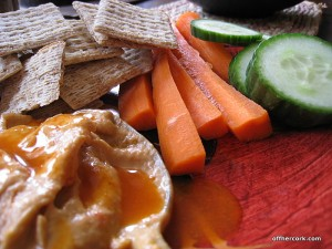 crackers, carrots, cucumbers, and hummus