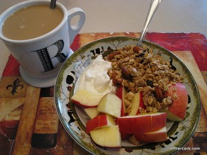 Coffee, apple, yogurt, and granola