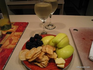 Fruit, chips, wine