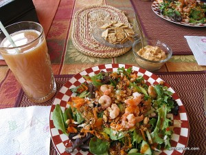 Juice, salad, crackers, and hummus