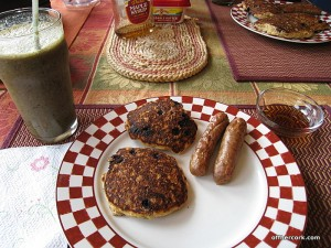 Smoothie, pancakes, and sausage
