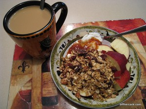 Coffee, yogurt, granola and an apple