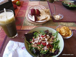 Smoothie, salad, crackers, apple