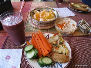 Smoothie, veggies, fish, crackers, and fruit