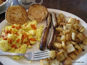 Eggs, sausage, potatoes, and english muffin