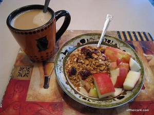 coffee, yogurt, granola, and an apple