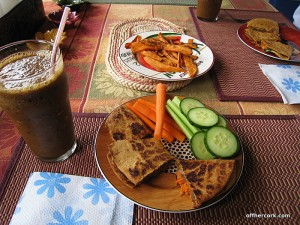 Smoothie, quesadilla, and veggies
