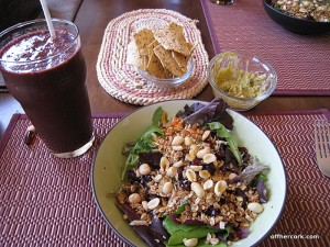 Smoothie, salad, chips, and guacamole