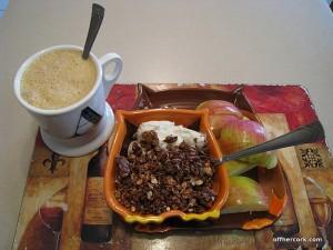 Coffee, fruit, yogurt, and granola