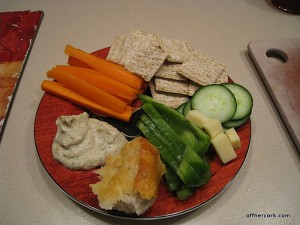 veggies, hummus, crackers, cheese, bread