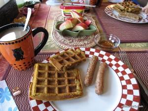coffee, waffles, sausage, and apple