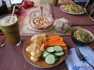 Smoothie, fruit, veggies, crackers, hummus, and noodles