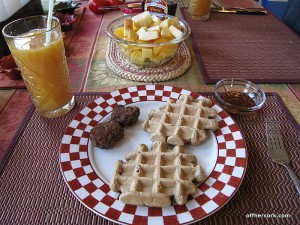Waffles, sausage, and fruit