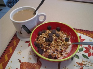 Coffee and yogurt with granola.