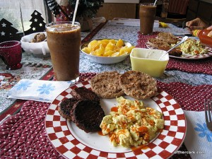 Eggs, sausage, toast, smoothie, fruit