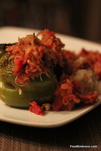 Mashed potato stuffed peppers with a tomato and sauerkraut sauce.