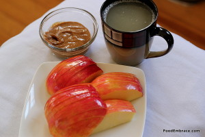 Apple, almond butter, mug of broth