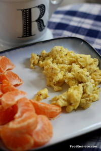 Scrambled eggs and mandarin oranges