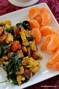 Scramble with tomatoes, spinach, and potatoes. Mandarin oranges