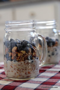 Paleo granola, coconut cream, blueberries