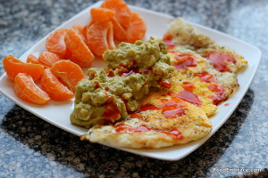 Fried eggs, guacamole, mandarin oranges