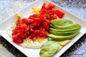 Fried eggs with peppers, onions, and avocado