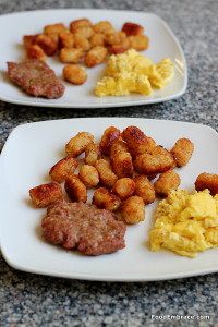 Scrambled eggs, sausage patties, tots