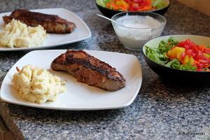 Steaks, mashed potatoes, side salad