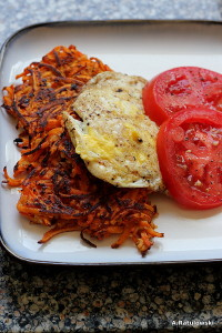 Sweet potato cakes, fried egg, tomato slices