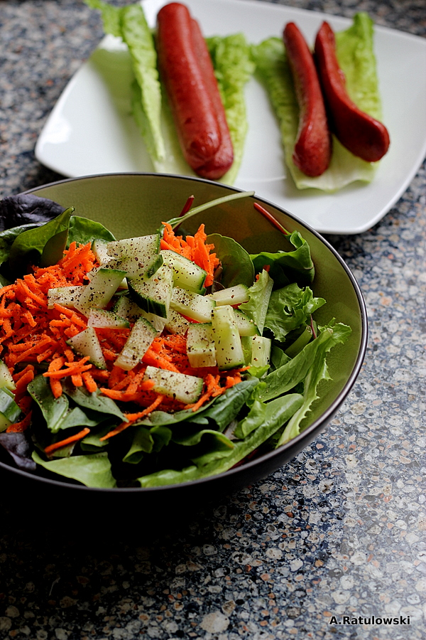 Salad and hotdogs